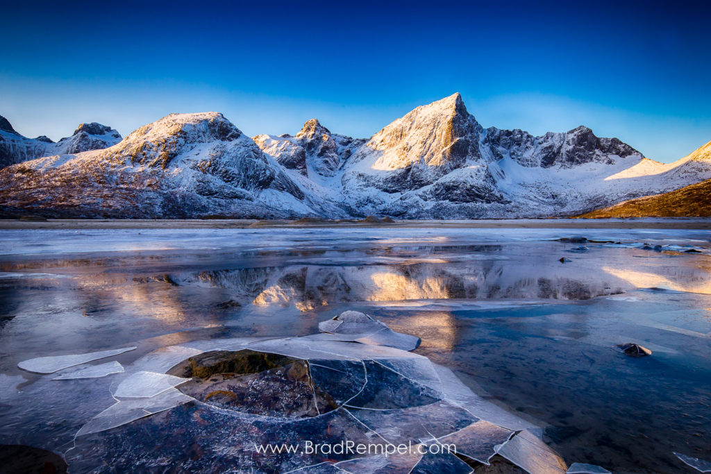 Flakstadpollen Lake, frozen lake, Ice, Kilanleira, Lofoten, Lofoten Islands, Middagselva, Mount Kollfjellet, Mount Stortinden, Mountains, Norway, reflection - Brad Rempel