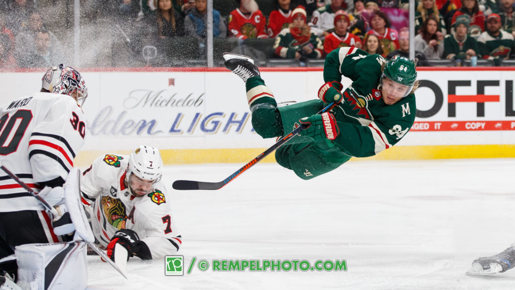 Oct 11, 2018; Saint Paul, MN, USA; Minnesota Wild forward Mikael Granlund (64) shoots in the second period against Chicago Blackhawks goalie Cam Ward (30) at Xcel Energy Center. Mandatory Credit: Brad Rempel-USA TODAY Sports